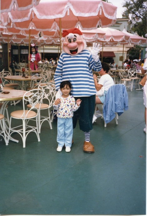 Santos as a child at Disneyland